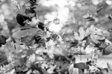 Leaves go everywhere during this autumn photo shoot with two children.