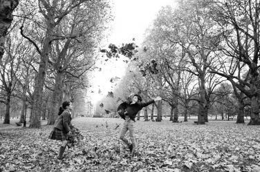 A brother and sister go wild with autumn leaves during their professional photo shoot by London photographer Helen Bartlett.