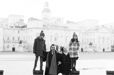 A family poses for a professional photo at Horseguards Parade near London's Whitehall.