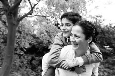 A boy hugs his mother during a photo shoot in London.