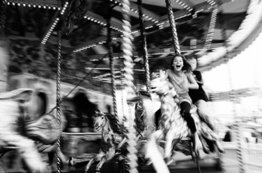 A tween portrait taken on a merry-go-round in London. The portrait is taken by professional Helen Bartlett.