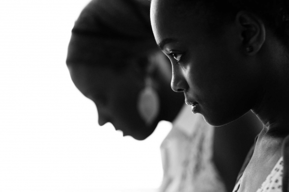 Two teenagers captured in beautiful light by professional photographer Helen Bartlett.