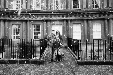A teenager, her dog and parents in this portrait taken in Bath's Circus in the snow.