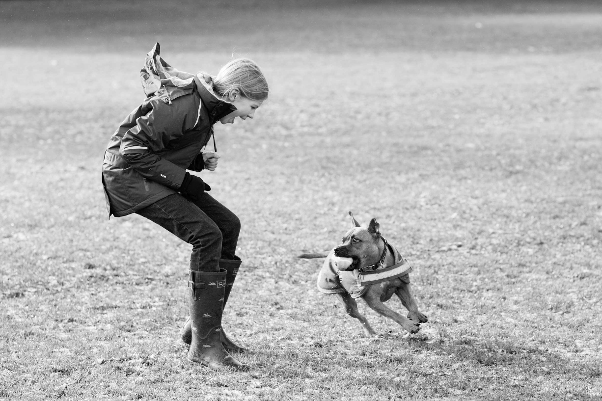 A teenager and her dog do what they love the most - play fetch - as captured by London portrait photographer Helen Bartlett.