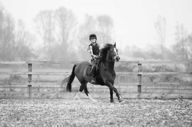 Teenagers and their hobbies such as this teen and her horse can provide a focus for teenage portraits that show personality without self-consciousness.