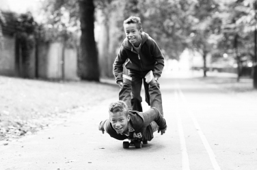 Teenage brothers find a new way to skateboard in one of London's parks. The teenage photo is by Canon Ambassador Helen Bartlett.