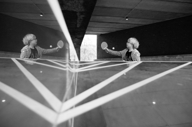 A teenager plays a game of ping pong in this reflective portrait by London photographer Helen Bartlett.