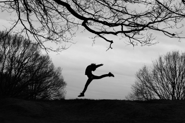 A teenager leaps through the air in this striking silhouette portrait by a London photographer.