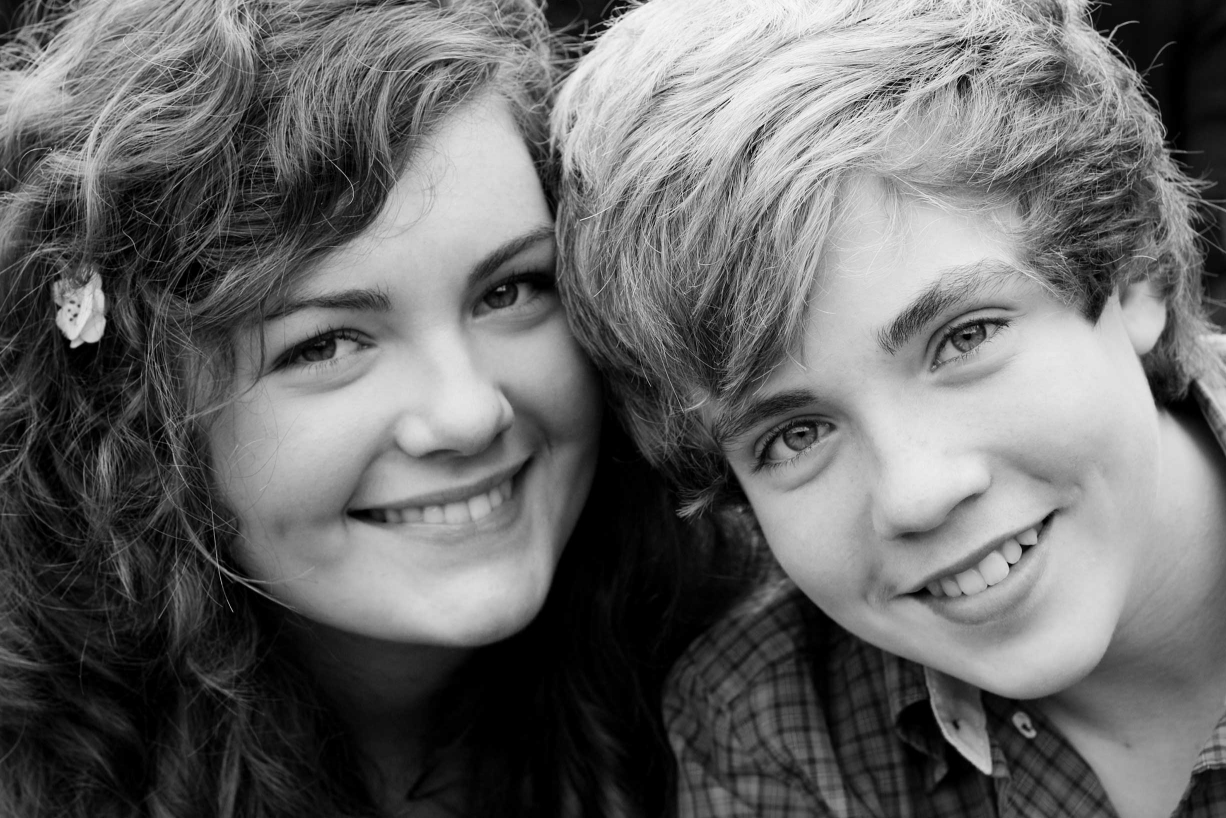 London teenager photographer Helen Bartlett captures natural smiles from these two two teenagers.