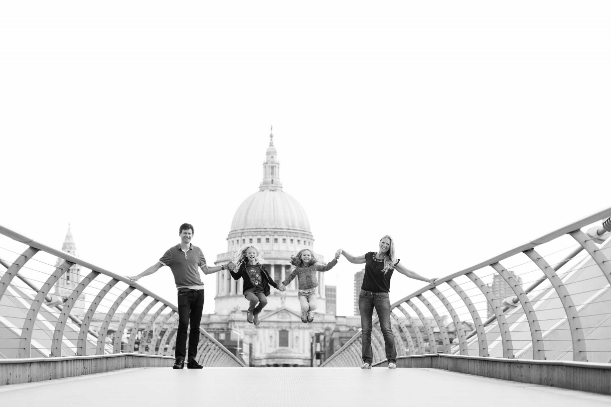 A family portrait on the London Millennium Footbridge in front of St Paul's Cathedral.