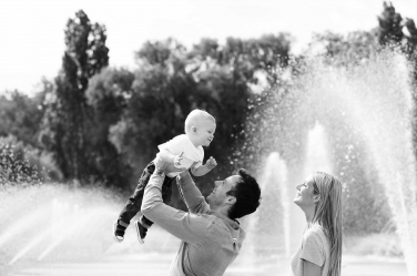 A family portrait in front of the Hyde Park fountains.