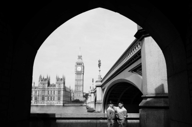 A black and white family portrait in front of Big Ben and the Houses of Parliament. The family portrait is one of a series taken around London's iconic landmarks.