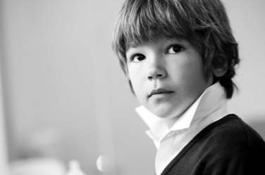 Black and white portrait of a boy having a quiet moment. It was taken during a shoot with London photographic artist Helen Bartlett.