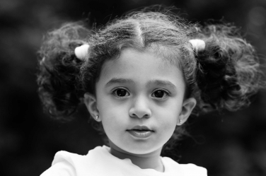 A black and white portrait of a young girl during a London vacation portrait shoot with her family.