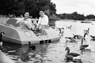 London photographer Helen Bartlett captures this family visiting London in a paddleboat on the Serpentine in Hyde Park, one of the capital's Royal Parks.