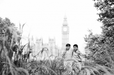Two brothers pose in green space near London's iconic Big Ben and the Houses of Parliament during their family portrait shoot.