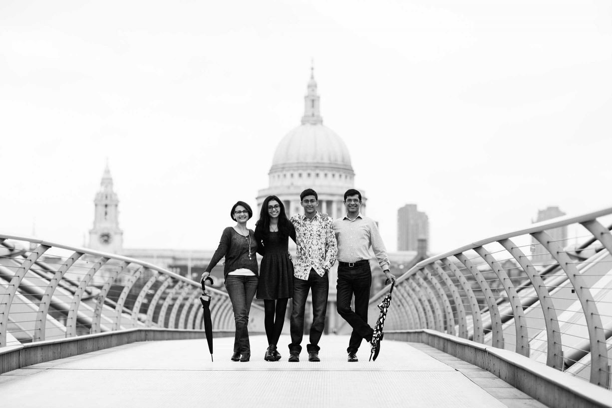 You have to get up early to beat the crowds on London's Millennium Bridge. This family had their portraits taken by photographer Helen Bartlett during their visit to London.