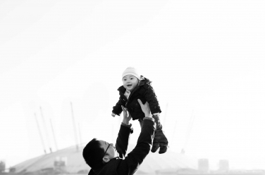 A father holds his baby aloft during a London portrait shoot in front of the 02 Centre in Greenwich, in south-east London.