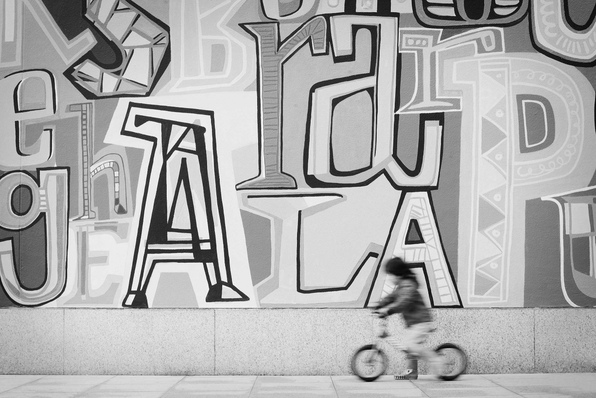 A child on their bicycle is photographed at just the right moment to give a fine art portrait.