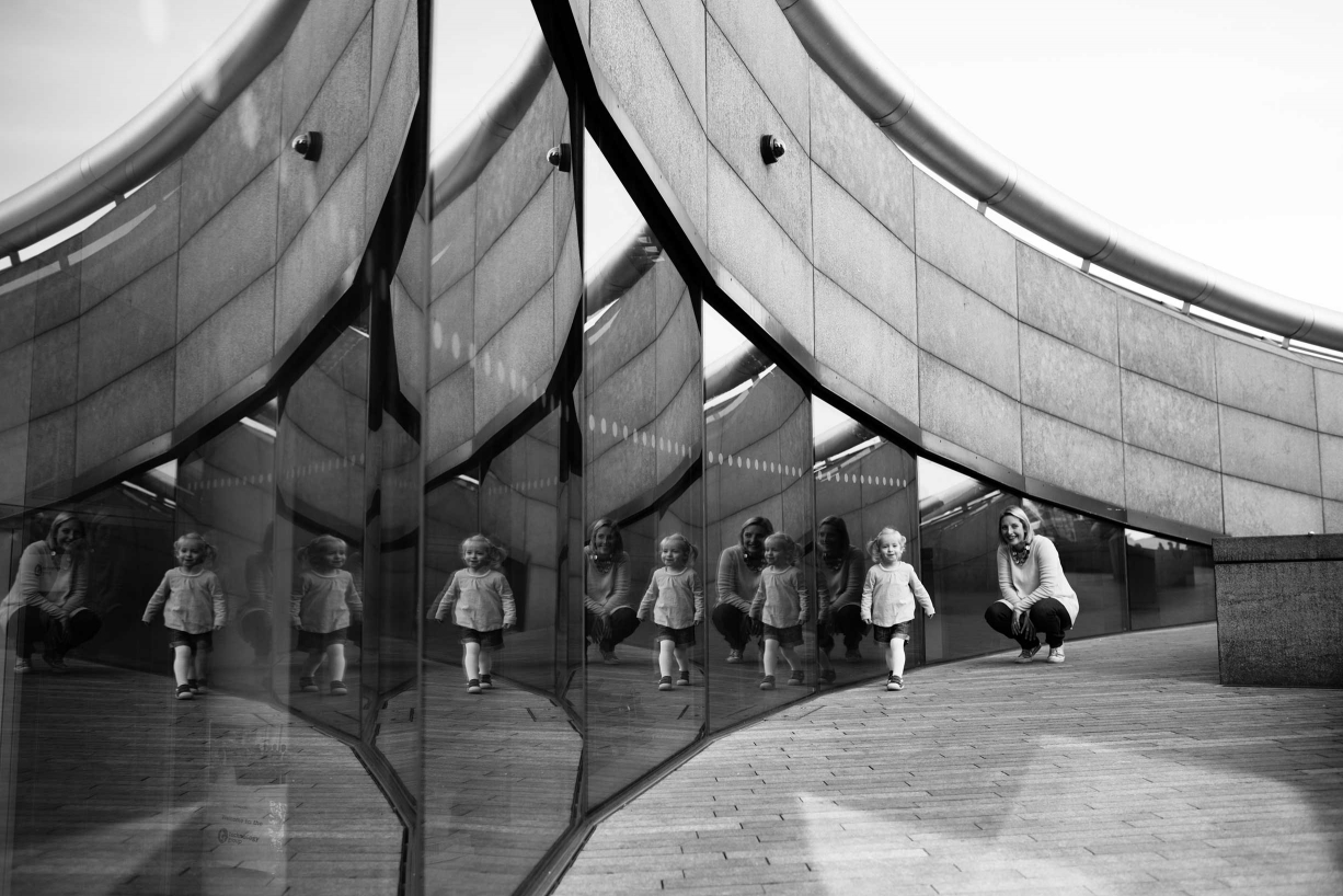 Fine art family photography has to have extra elements of creativity, such as the repetition from multiple reflections.