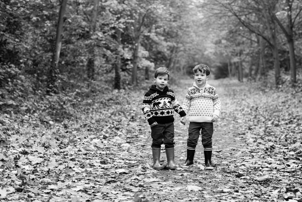 Observational or documentary portraits of two siblings in black and white taken in Battersea Park.