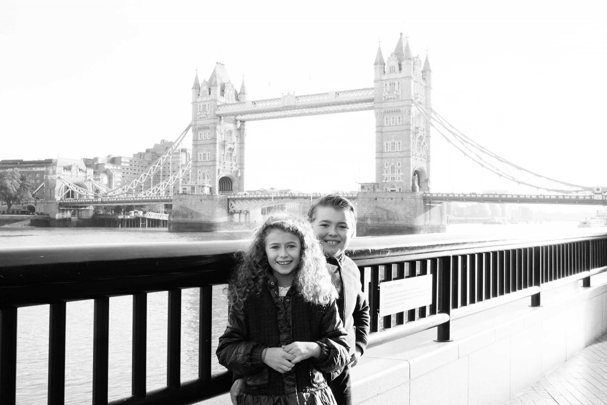 This fine art family portrait features London's Tower Bridge in the background.