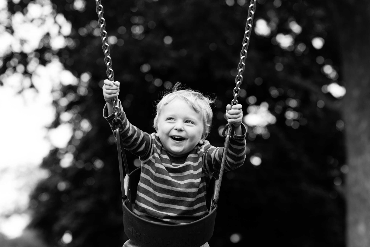 Is there anything more fun than a swing in a park? This child doesn't think so!