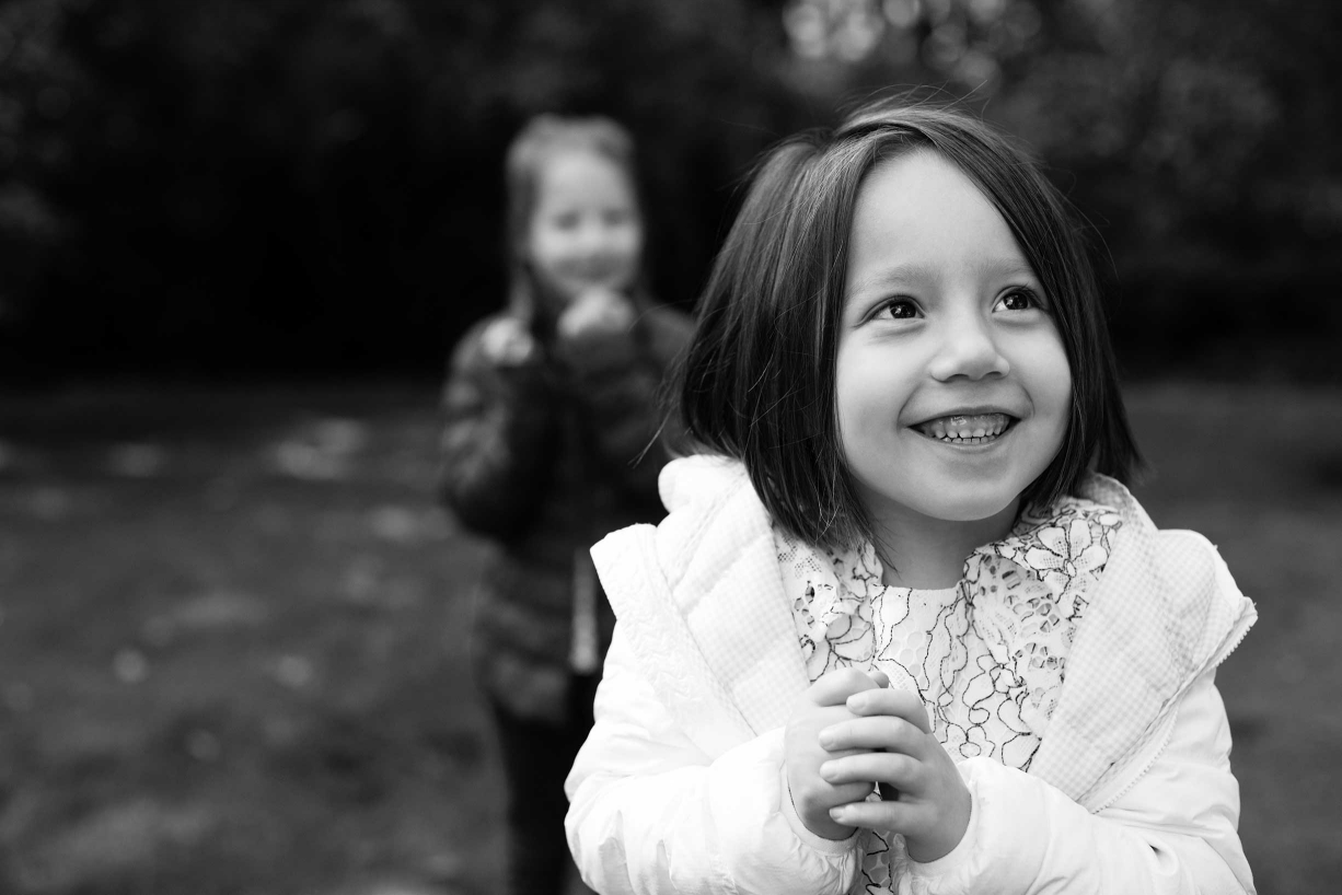 A gleeful smile from this little girl during a Chiswick family photo session by London photographer Helen Bartlett.