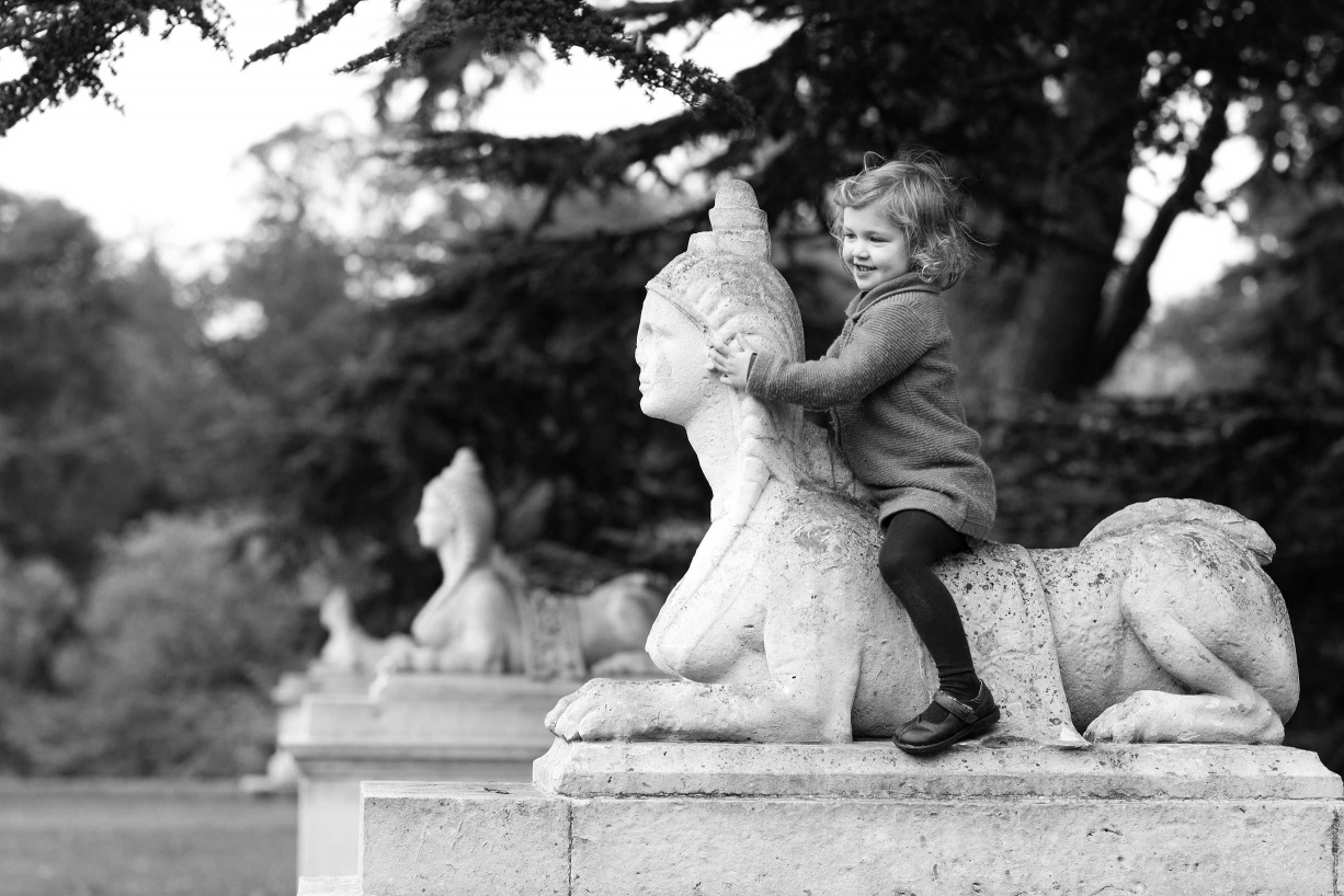A statue is a horse for this little girl during a Chiswick family portrait session.