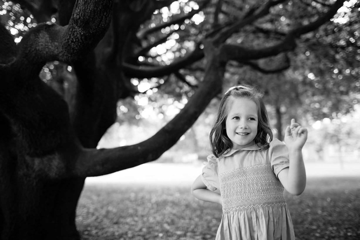 Chiswick Park makes a wonderful backdrop for family portraits in black and white. Here is a little girl surrounded by trees.