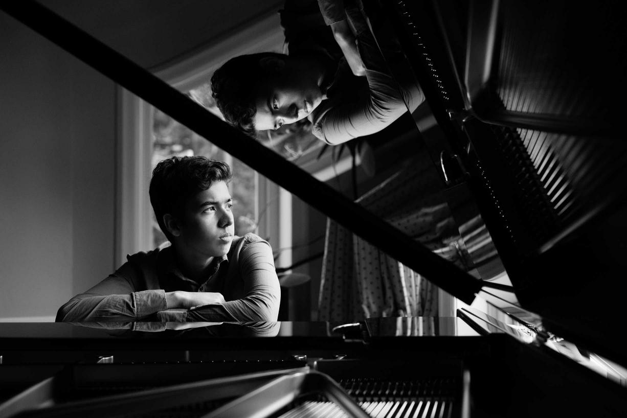 Reflections bring this Dulwich family photograph of a teen and his piano to life.