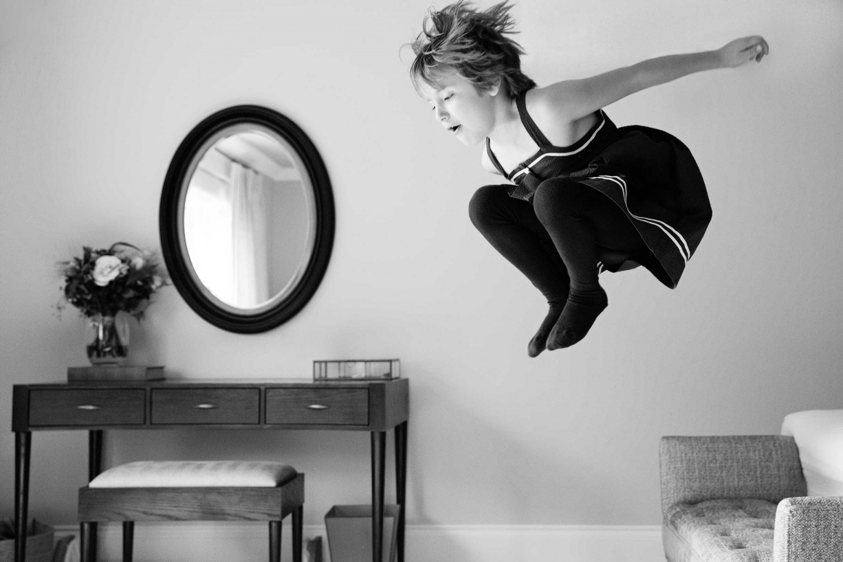 Jumping for joy in this Dulwich family portrait in black and white.
