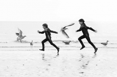Fine art family photography has strong composition - like these boys running on the beach with seagulls in between. A split second either way would have completely changed this portrait.