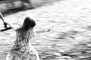 A girls runs quickly through the park during her fun family photos in Hammersmith.