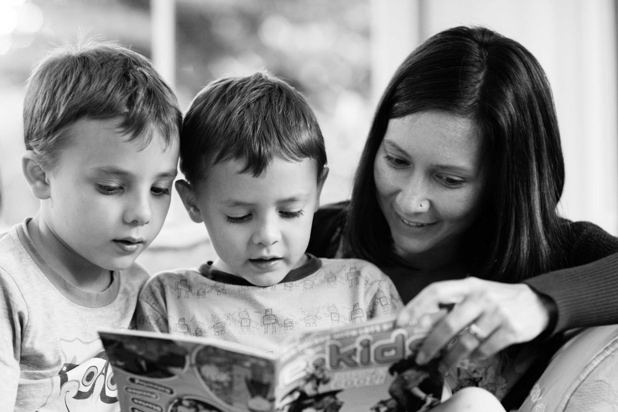 Reading stories is one of the many activities this family did during their family photo session in Hammersmith.