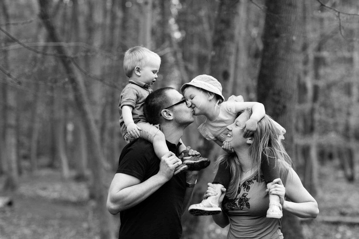 Family snuggles and kisses during this Hampstead family portrait session.
