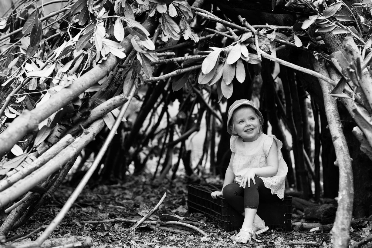 A den made from sticks and leaves is just the place to hide during fun and games in Hampstead.