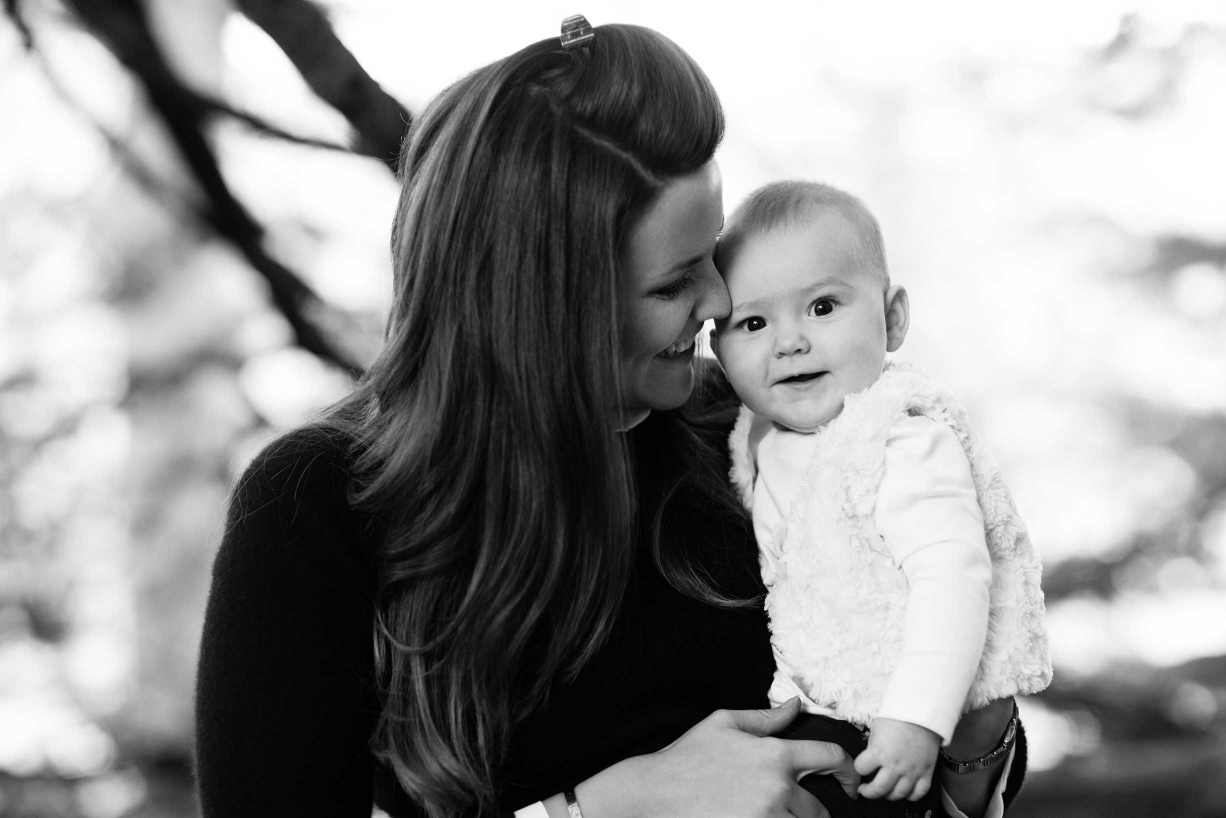 A mother kisses her baby in this professional family shoot in Kensington and Chelsea.
