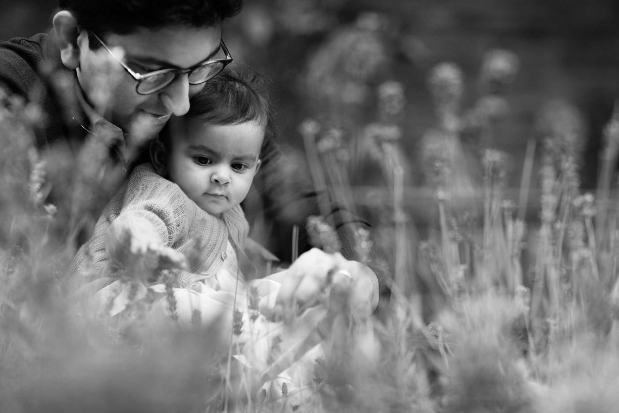 This child has a contemplative gaze during her family photos in Kensington, London.