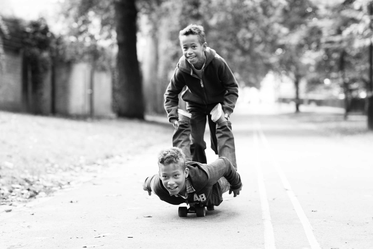 This black and white portrait shows a family playing in Battersea Park.