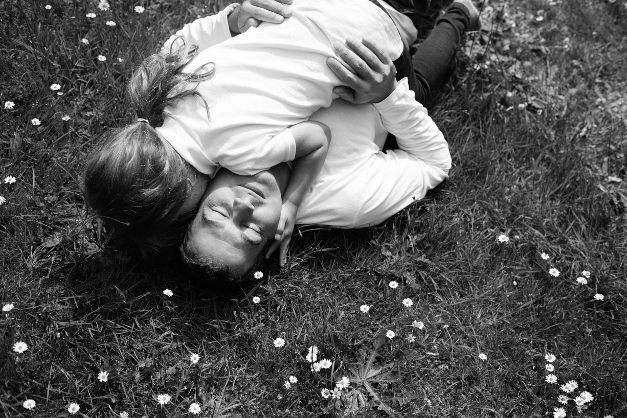 Lying on a daisy-strewn meadow, you can dream all day, like this girl in a family portrait from Helen Bartlett, taken in Kew Gardens.