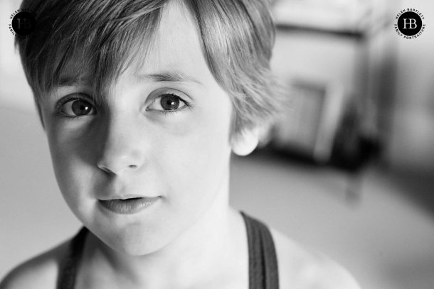 A black and white family photo of a boy in close up.