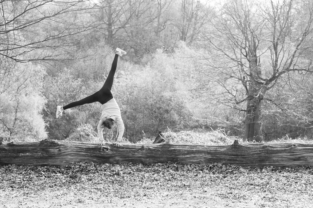 Cartwheeling through Wimbledon Common - family portraits can be filled with games and delight.