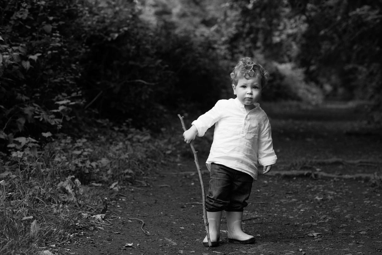 A dark background can help the subject stand out - in this case, a small boy.