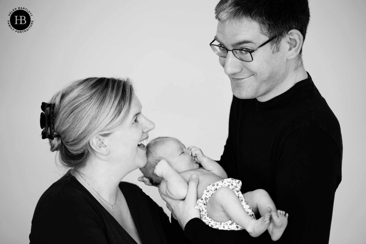 Two parents wear black for their newborn shoot at home read helen bartletts complete guide