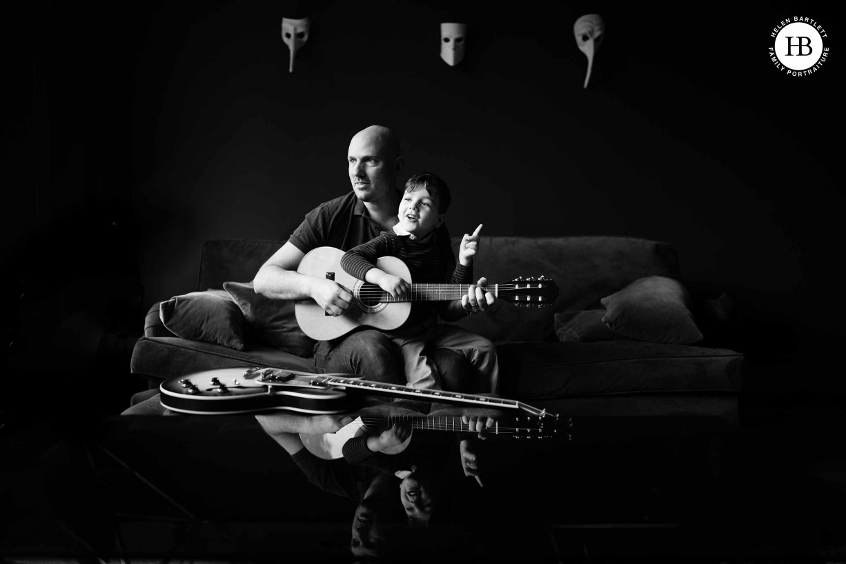 boy-plays-guitar-with-dad