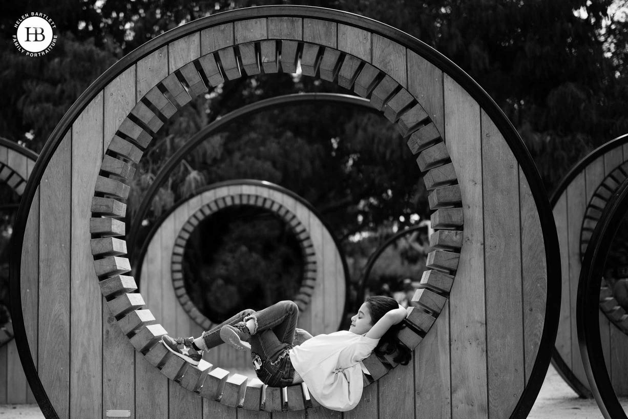 girl-sleeps-wooden-sculpture