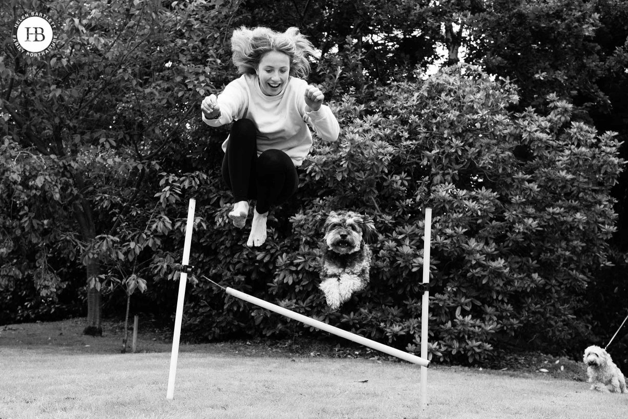 girl and dog jumping on family photo shoot in Sevenoaks