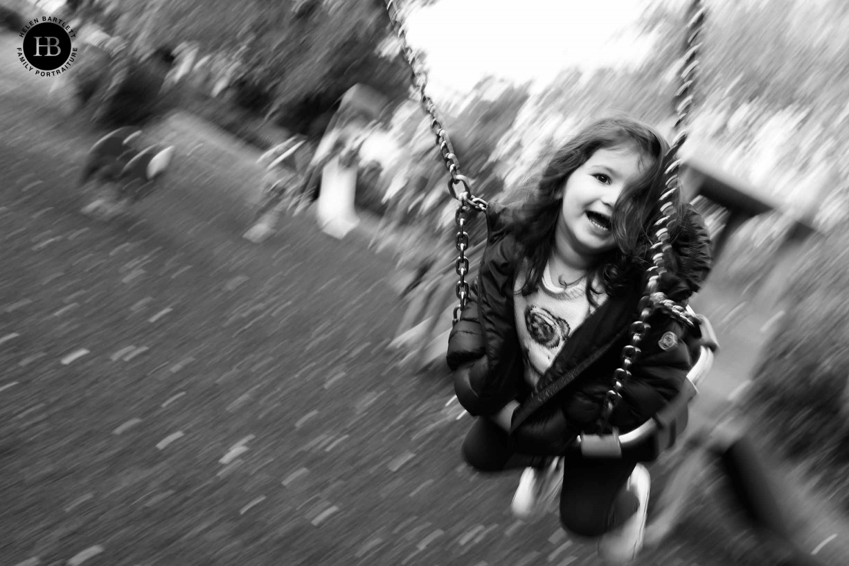 panning shot of girl on swing with canon 1DX mark III