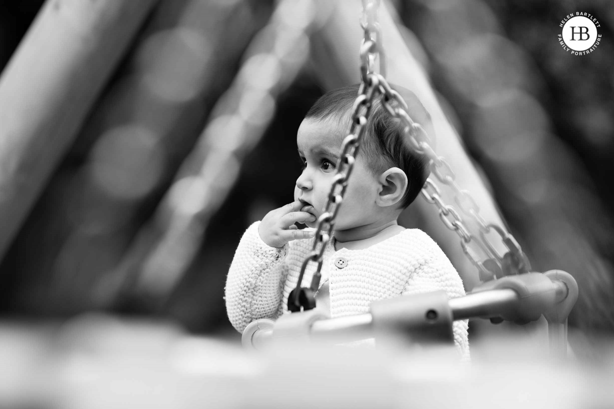 baby on the swings photographed with a shallow depth of field for visual effect